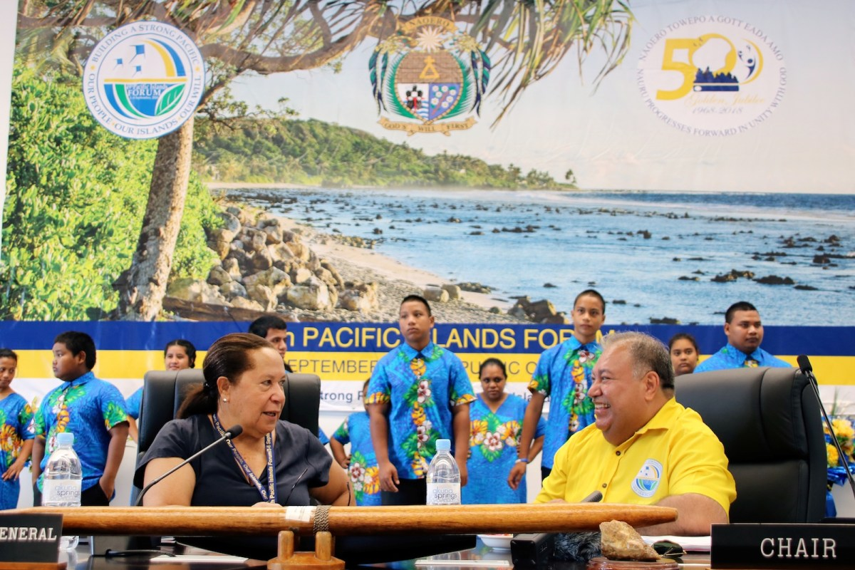 Meg Taylor, left, secretary-general of the Pacific Island Forum, and Nauru's President Baron Waqa, right, attend the 'Small Islands States' meeting ahead of the Pacific Islands Forum on Nauru on Sept 3. Talks at the 18-nation Forum have focused on the threat from climate change and China's rising influence in the region. Photo: AFP / Mike Leyral