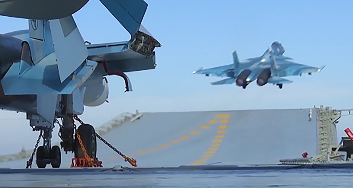 A Russian jet takes off from the Admiral Kuznetsov aircraft carrier in the eastern Mediterranean off the Syrian coast during a strike against Islamic State (IS) positions in Syria in Nov 2016. Photo: AFP / screen grab from Russian Defense Ministry video.
