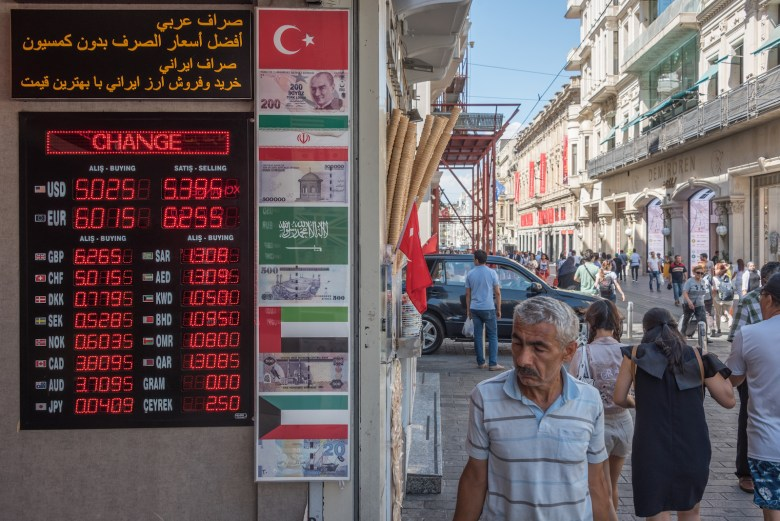 Pedestrians pass by a foreign exchange office in Istanbul on 9 August as the Turkish lira continues to lose value against major international currencies and inflation skyrockets. Photo: Diego Cupolo/NurPhoto