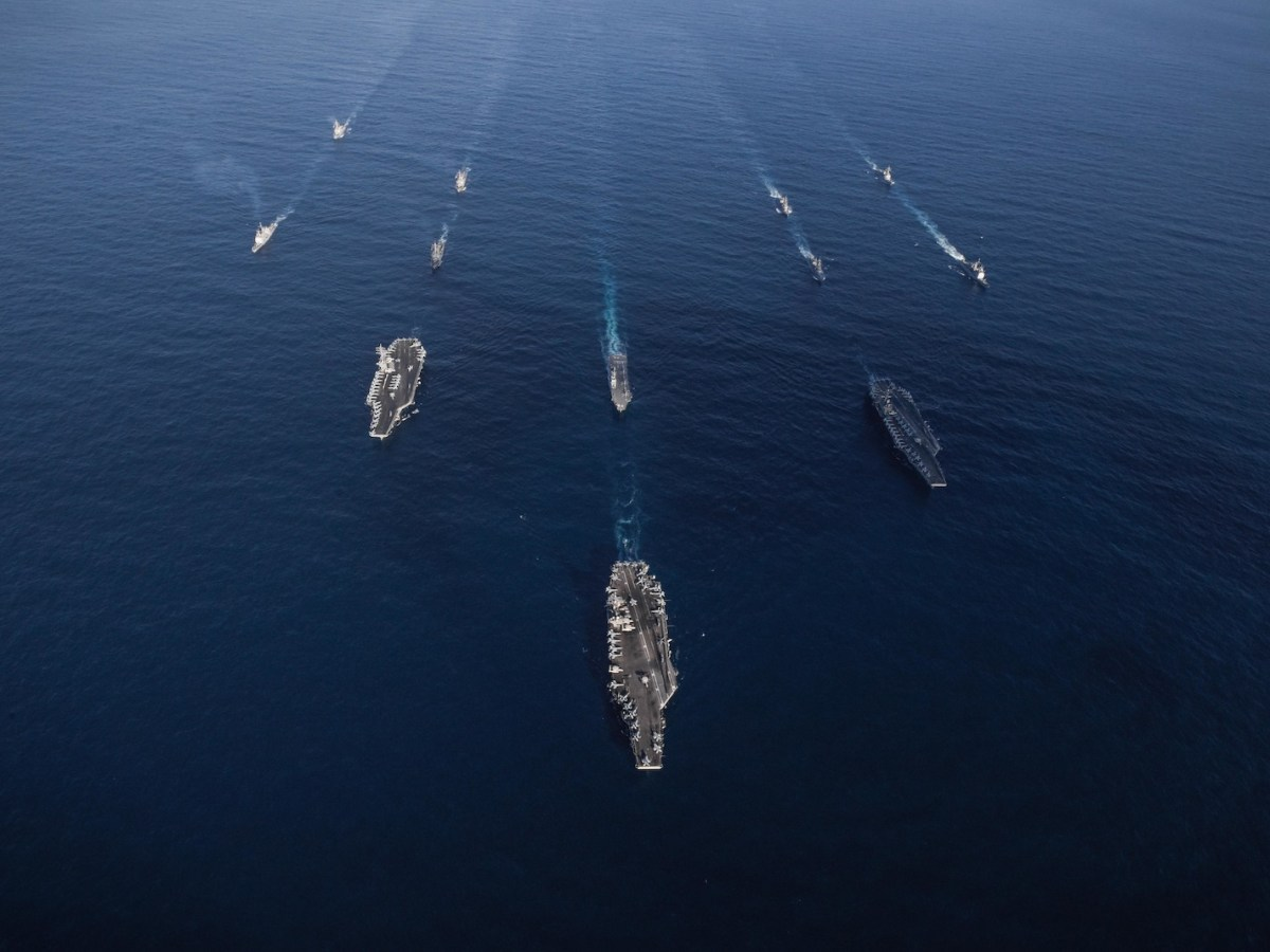 The USS Ronald Reagan, USS Theodore Roosevelt and USS Nimitz Strike Groups transit in the Western Pacific with ships from the Japanese Maritime Self-Defense Force on November 12, 2017. Photo: AFP/US Navy/Anthony Rivera