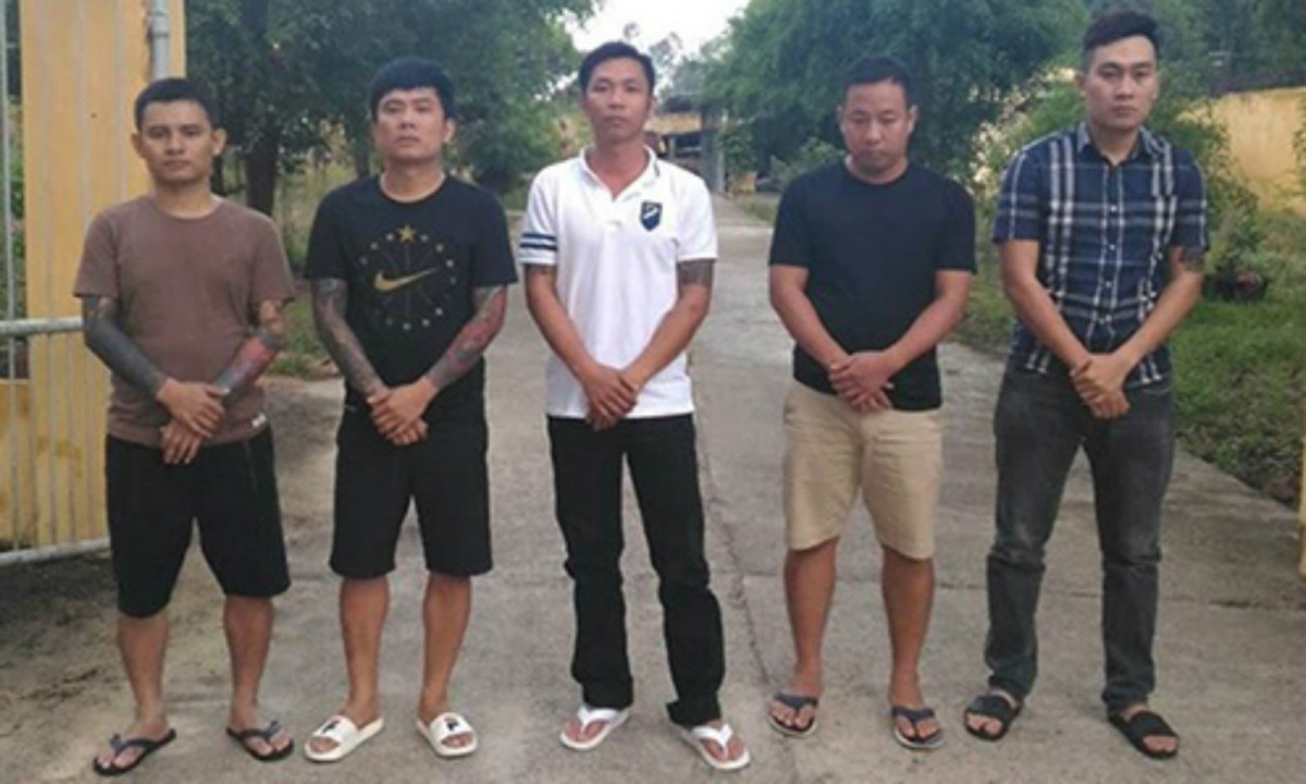 Five men from the gambling ring who were arrested. Photo courtesy of Quang Nam police.