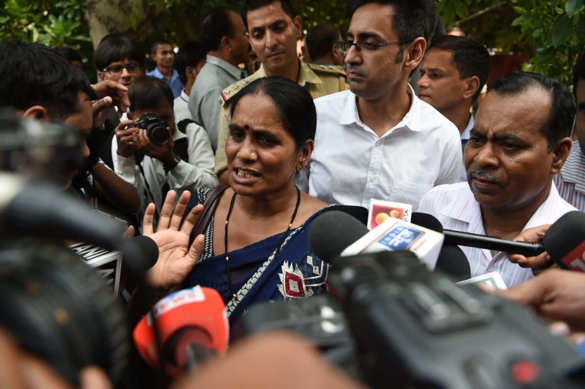 Asha Singh, the mother of a woman who was killed in a gang-rape in 2012, talks to the media. The case open the floodgates of sexual harassment and abuse claims across India. Photo:  AFP