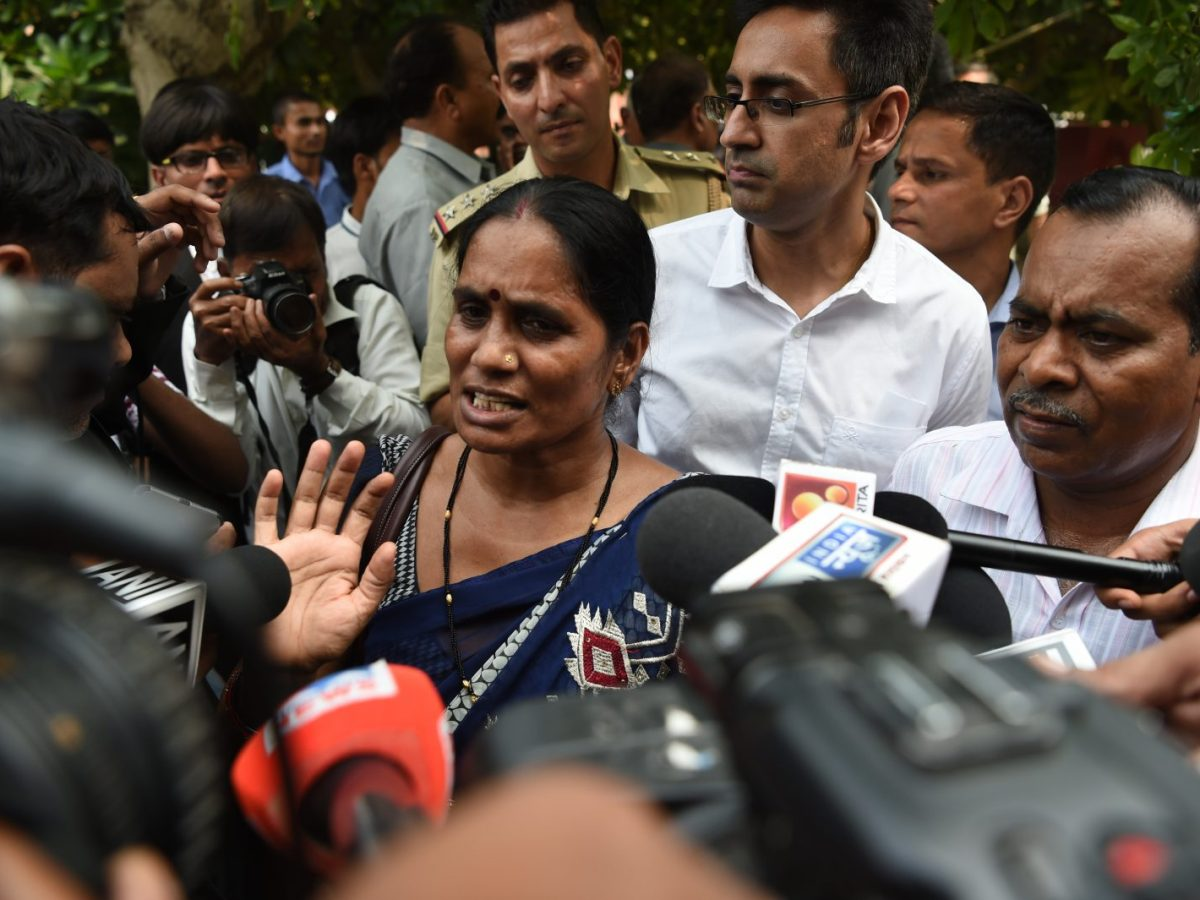 Asha Singh, the mother of a woman who was killed in a gang-rape in 2012, talks to the media. The case open the floodgates of sexual harassment and abuse claims across India.Photo: AFP