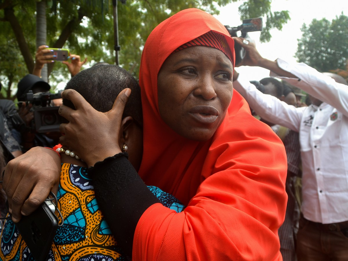 Founder of Bring Back Our Girls (BBOG) advocacy group, Oby Ezekwesili (L) is comforted by Aisha Yesufu, a member of the group, during a protest in the Nigerian capital Abuja on October 16, 2018, following the killing of a kidnapped female Red Cross worker by Islamic State-allied Boko Haram jihadists. - Boko Haram jihadists have killed another kidnapped female aid worker in northeast Nigeria, the government said, a month after one of her colleagues was murdered. (Photo by Mudashiru ATANDA / AFP)