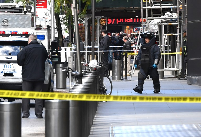 A New York Bomb Squad unit exits the Time Warner Building on October 24, 2018, where a suspected explosive device was found in the building after it was delivered to CNN's New York bureau. Photo: AFP