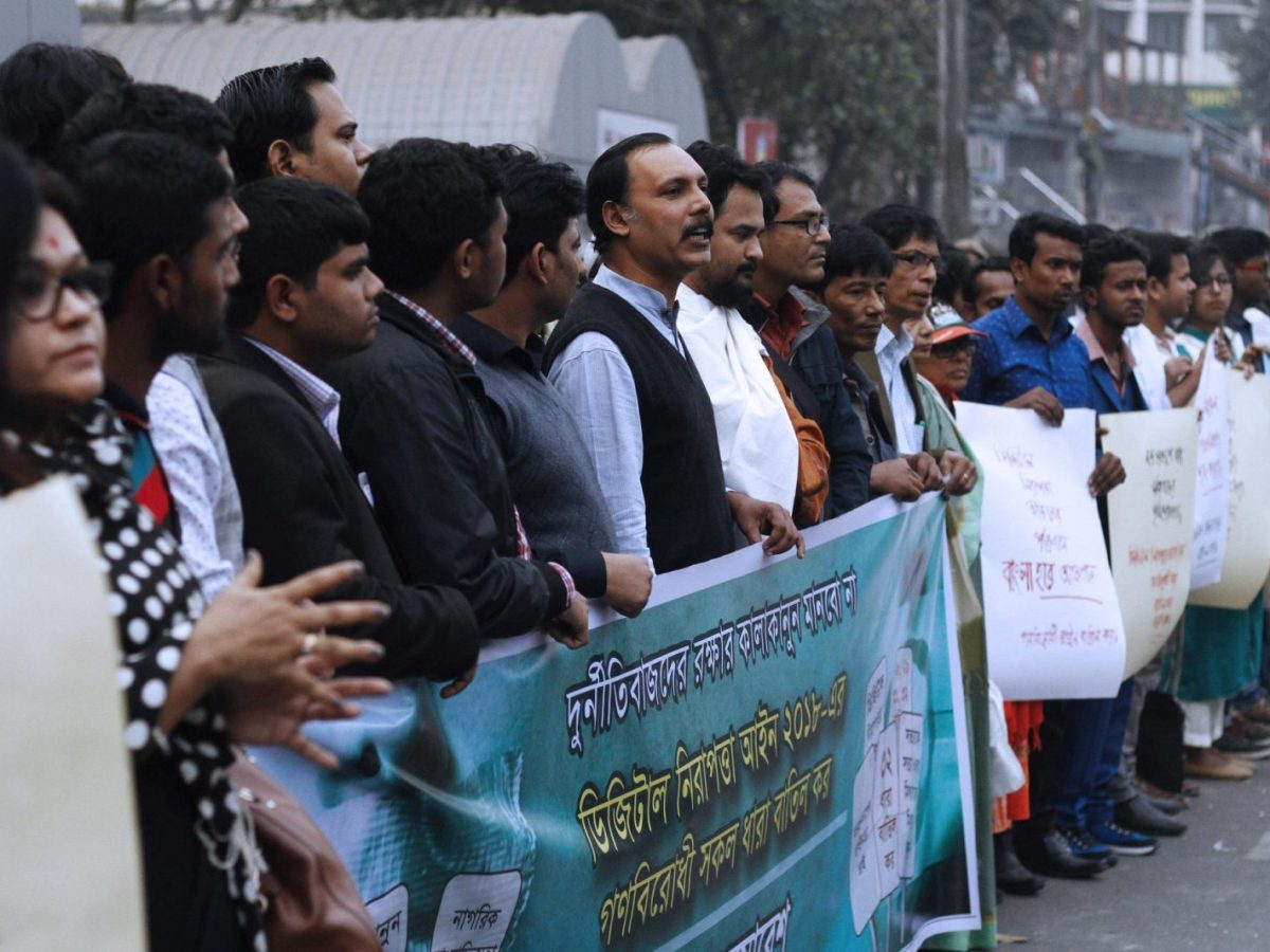 Activists in Bangladesh hold placards and a banner during a protest against the Digital Security Act in Dhaka on February. Photo: AFP / Rehman Asad