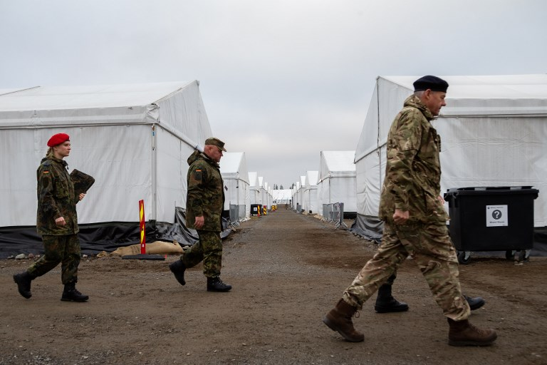 German soldiers walk in a camp of the German Armed Forces in Norway earlier this month. Photo: dpa via AFP
