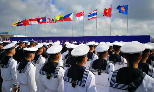Chinese seamen and their counterparts from ten ASEAN navies take part in a launch ceremony in Zhanjiang on Monday. Photo: Xinhua