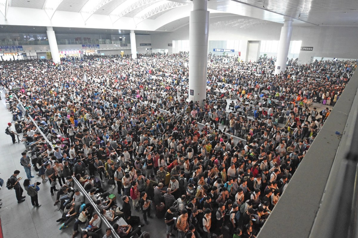 A packed waiting area was a regular sight at the Guangzhou South Station during the Golden Week holiday. Photo: Xinhua