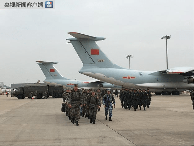 PLA troops boarding Ilyushin Il-76 transportation planes on the apron of Hong Kong's airport earlier this month. Photo: China Central Television