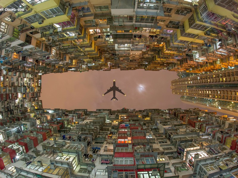 A plane flying over a cluster of dense tenement blocks in Hong Kong. Photo: Flickr/Tiffany Chang