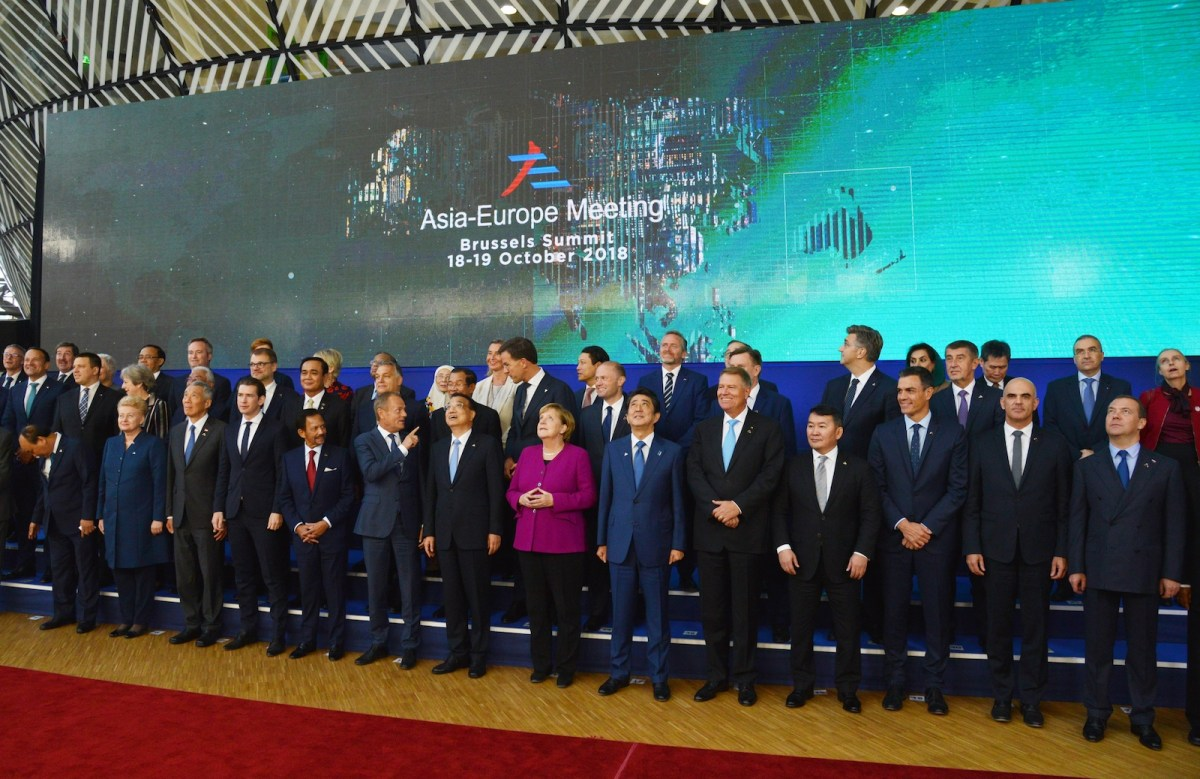 Asian and European leaders gather at the ASEM 12 summit last week with German Chancellor Angela Merkel, center in purple,  for a group photo in Brussels on October 19, 2018. Photo: Alexey Vitvitsky / Sputnik / AFP