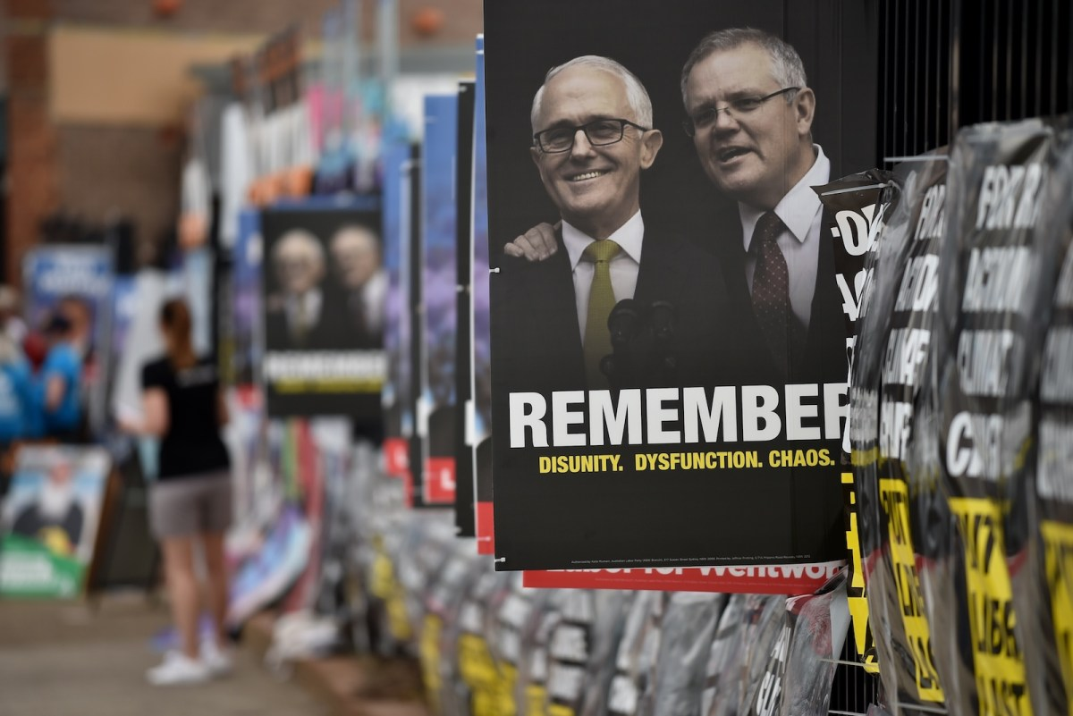 Posters are seen outside a polling station during the Wentworth by-election in Bondi in Sydney on October 20. Australia's conservative coalition lost the seat after a large swing against the Liberal Party, and its majority in parliament. PM Scott Morrison, seen right of Turnbull, now relies on independents to hold power. Photo: Peter Parks / AFP