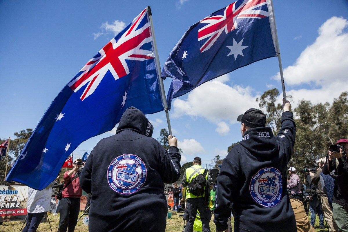 Anti-refugee protesters march with posters and Australian flags during pro and anti-refugee rallies in Eltham, Melbourne, Australia on November 5, 2016. Photo: AFP Forum via Anadolu Agency/Asanka Brendon Ratnayake