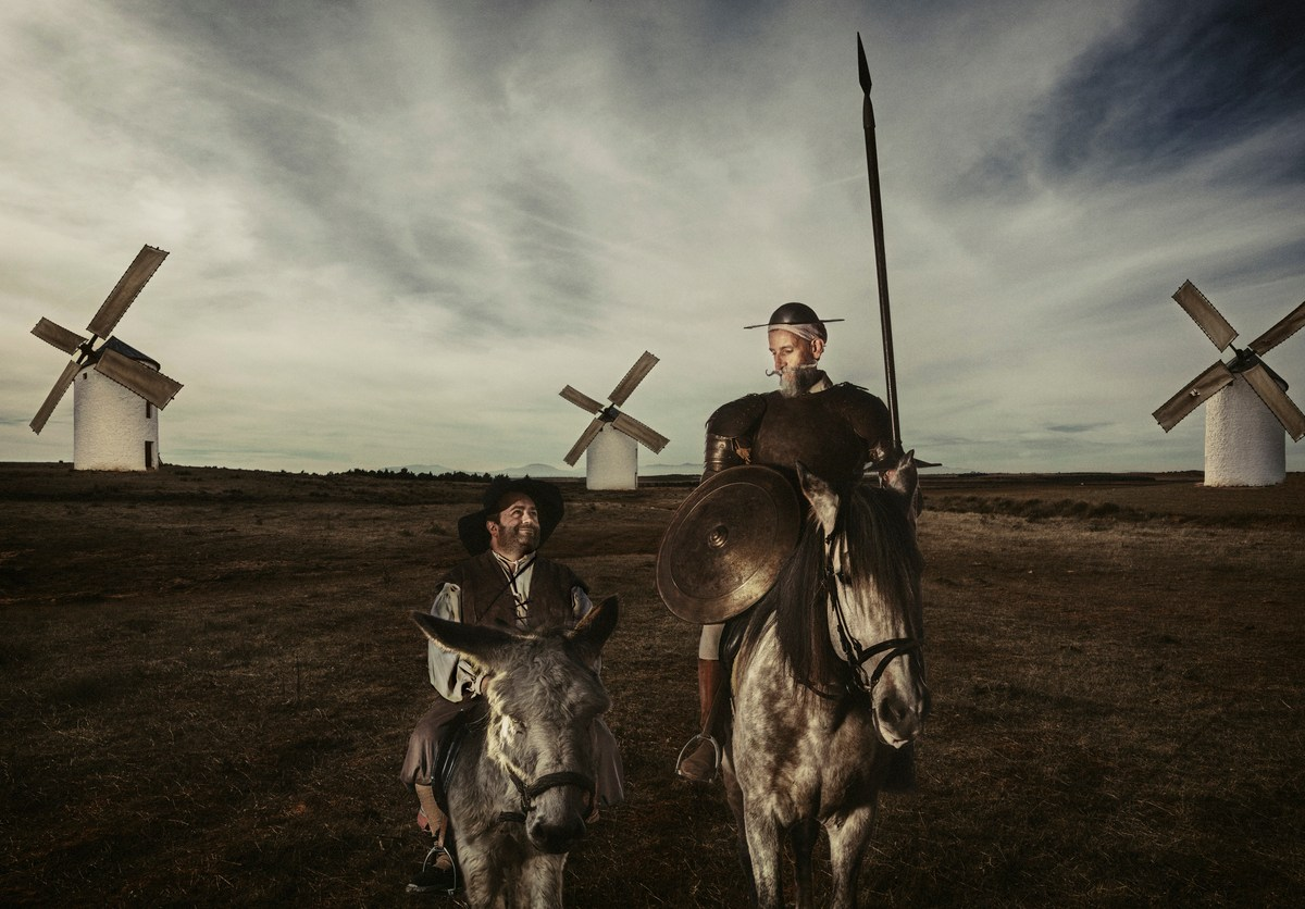 Don Quixote and Sancho panza riding through fields in La Mancha Spain