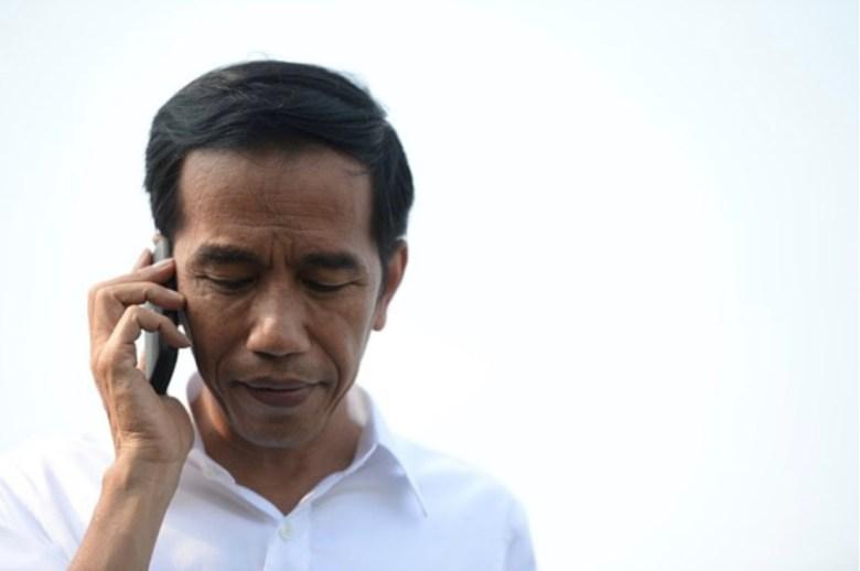 President Joko Widodo on a call. Photo: Pinterest