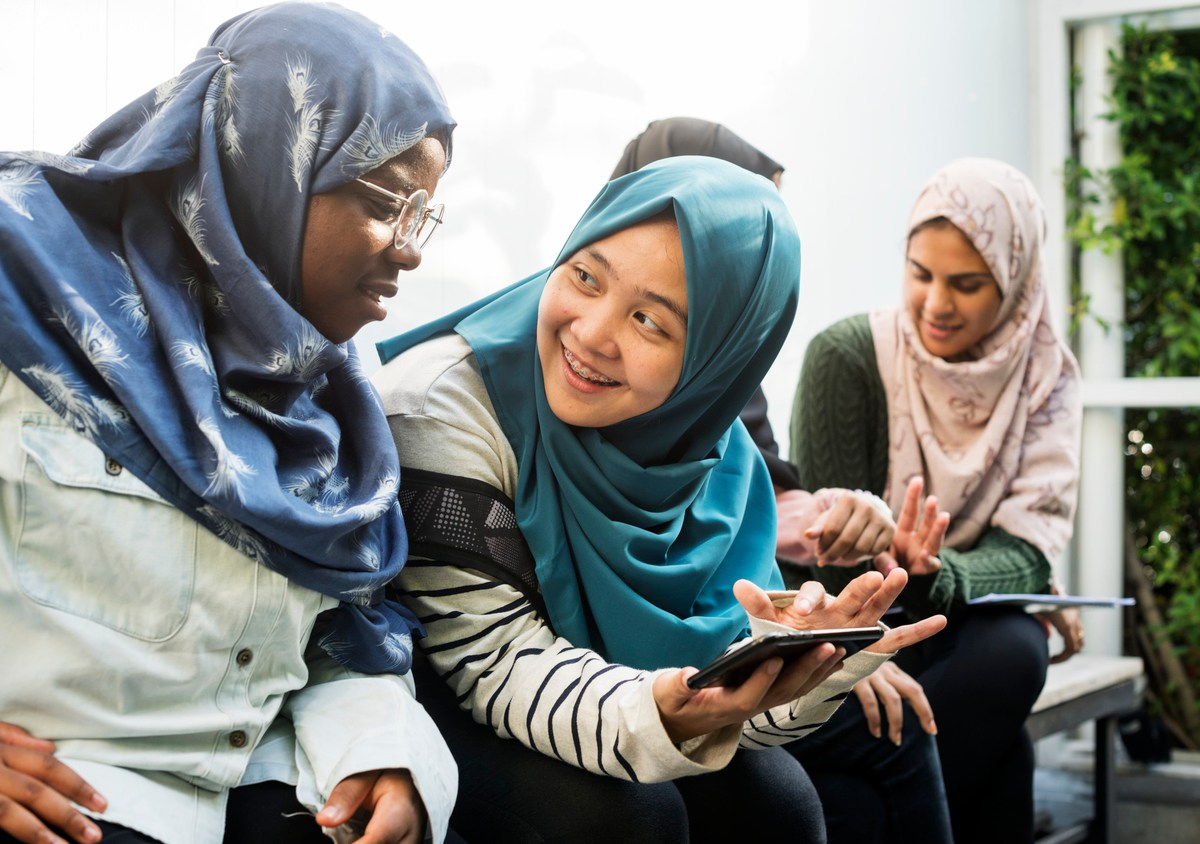 Group of students using mobile phone. Photo: iStock