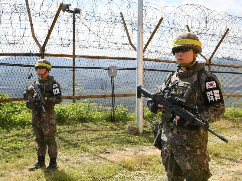 South Korean soldiers stand guard as their comrades conduct landmine clearing operations inside of the Demilitarized Zone dividing the two Koreas in Cheorwon, south of the DMZ. The two Koreas on October 1 started to remove landmines along a section of their heavily fortified border as part of a summit deal to ease military tensions, Seoul said. Photo: AFP/Song Kyong-Seok