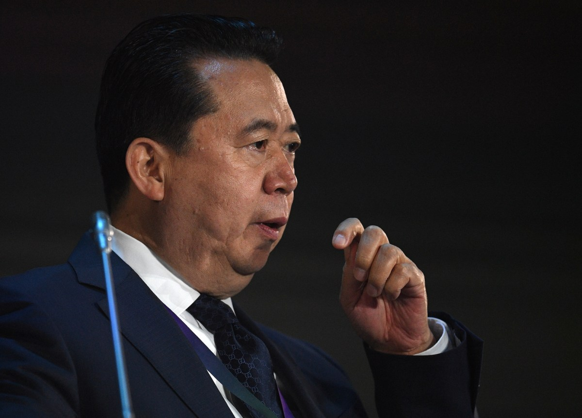 Former  Interpol President Meng Hongwei at a plenary meeting of the International Cybersecurity Congress. Photo: AFP /  Valeriy Melnikov / Sputnik