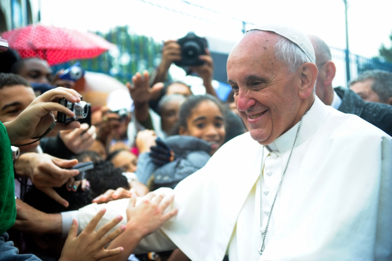 Pope Francis visits a favela in Brazil during World Youth Day 2013. Photo: Wikipedia