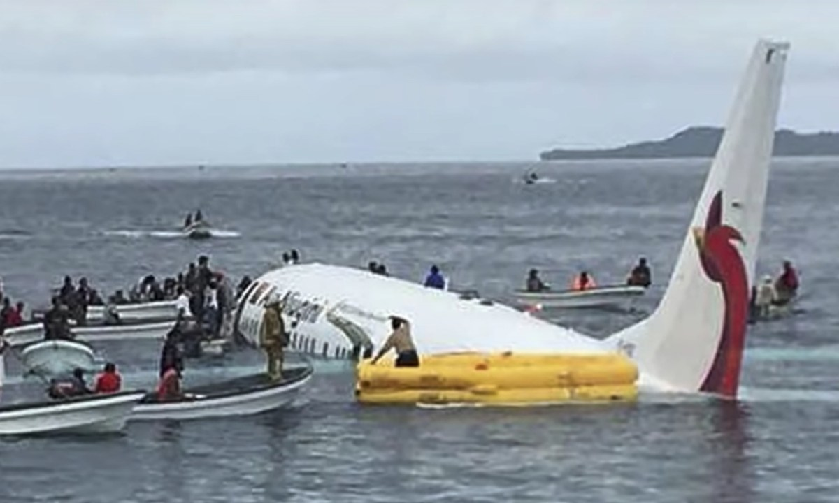 The plane missed the runway and crashed into the lagoon. Captured on Youtube.