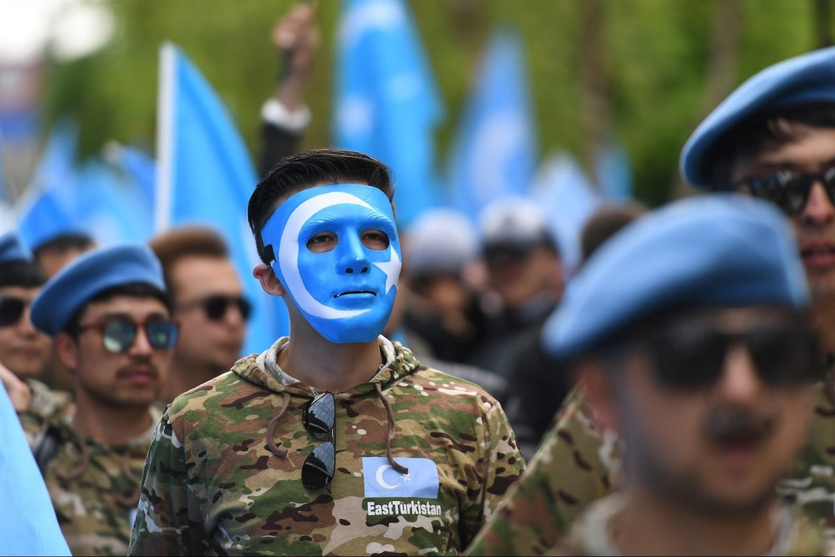 "Ethnic Uighurs take part in a protest march asking the European Union to call upon China to respect human rights in the Chinese Xinjiang region and the closure of ""re-education centers"" where some Uighurs are detained, during a march in Brussels, April 27, 2018. Photo:AFP/ Emmanuel Dunand"