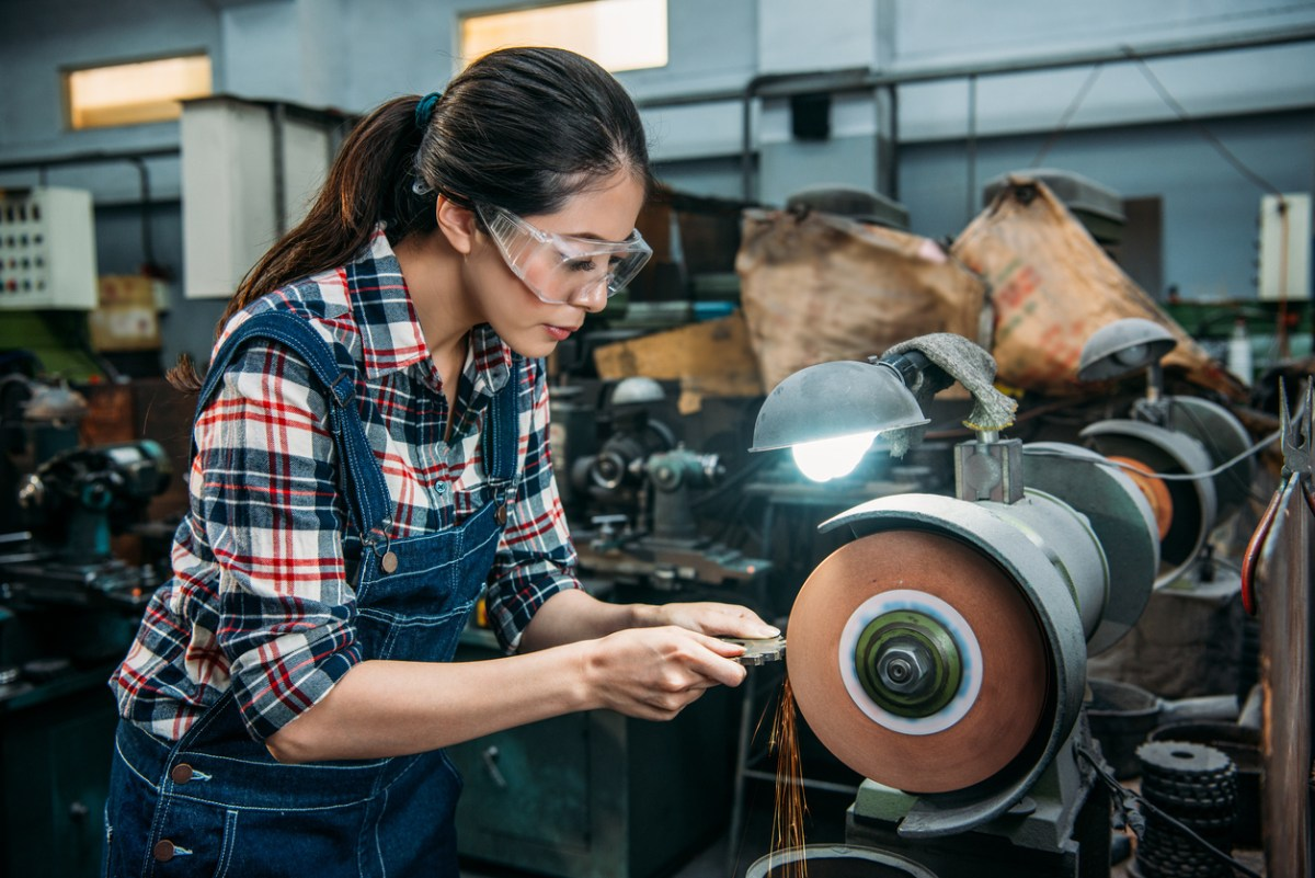 Female worker holding components metal grinding. Photo: iStock