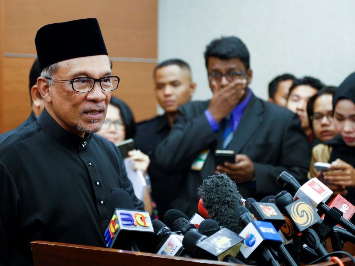 Anwar Ibrahim talks to reporters after being sworn in at Parliament in Kuala Lumpur on October 15, 2018. Photo: Adli Ghazali / Anadolu / AFP