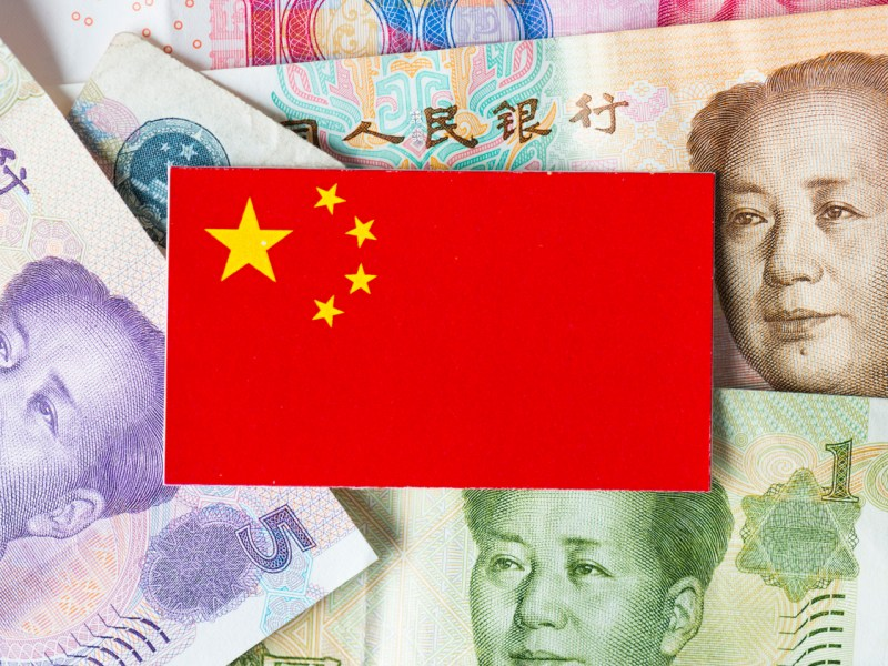 China flag with china paper currency. Image: iStock
