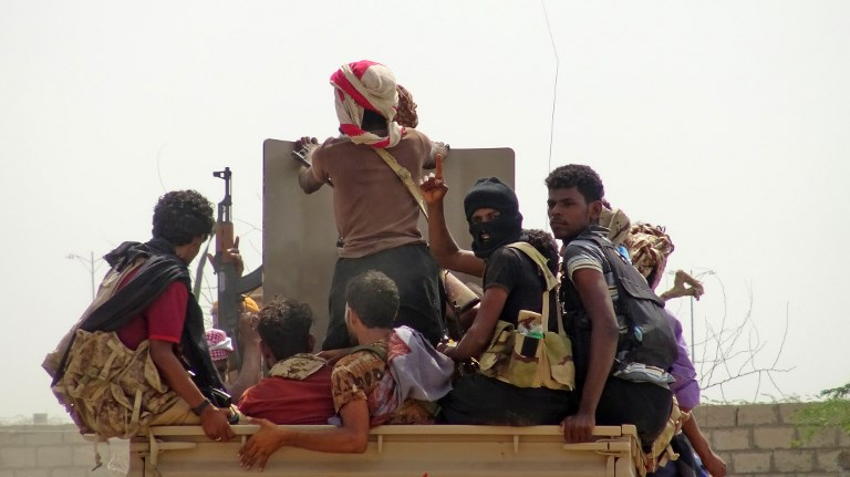 Yemeni pro-government forces ride in a military vehicle on the eastern outskirts of Hodeida as they fight for control of the city from Huthi rebels on November 10. Photo: AFP