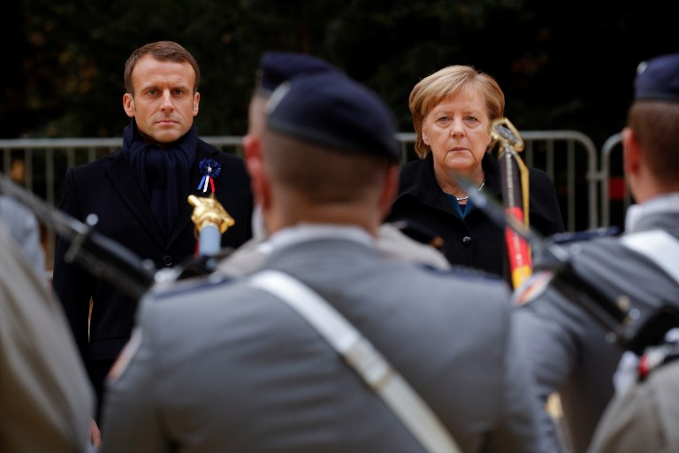 French President Emmanuel Macron and German Chancellor Angela Merkel review troops as part of a ceremony marking the 100th anniversary of the end of the First World War. Photo AFP/Philippe Wojazer