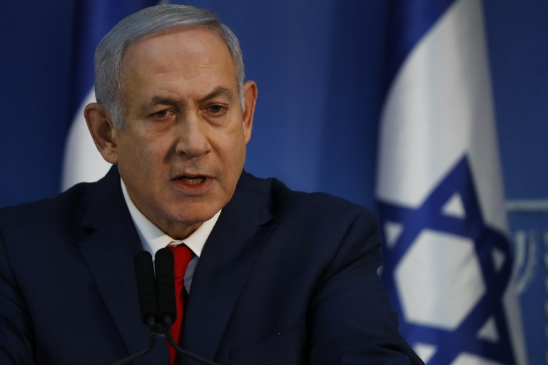 Israeli Prime Minister Benjamin Netanyahu speaks in a televised address to the nation on Sunday. Photo: AFP