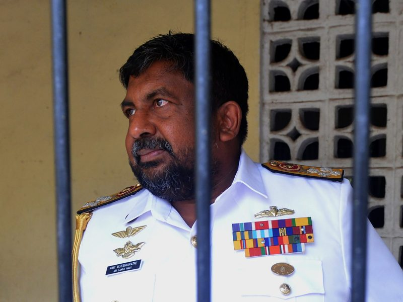 Top military officer Admiral Ravindra Wijegunaratne arrives at the Magistrate's Court in Colombo on Wednesday. Wijegunaratne was remanded in custody after weeks evading arrest for allegedly protecting the chief suspect in the murder of 11 people during the civil war. Photo: AFP/ Ishara S Kodikara