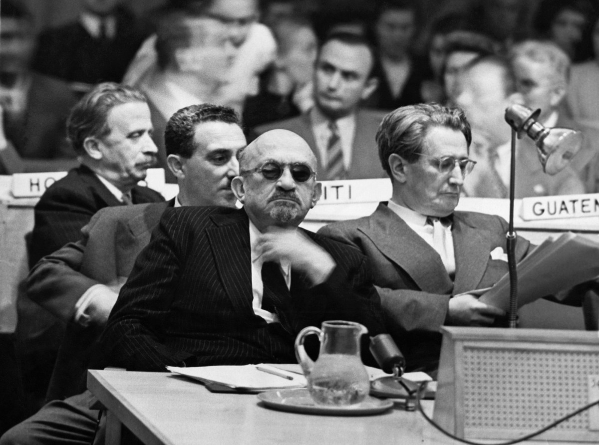 Head of the Jewish Agency for Palestine Chaim Weizmann, in dark glasses, listens in Oct 1947 as a member of the Arab Higher Committee explains why Palestine should not be split by the UN. But a month later the General Assembly voted to split Palestine into two states, one Jewish and one Arab. Photo: Acme News Pictures / AFP