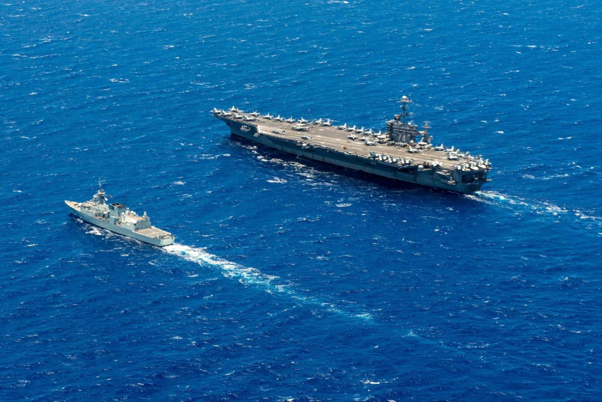 The HMCS Calgary steams alongside Nimitz-class aircraft carrier USS John C. Stennis in the Pacific Rim. Photo: AFP