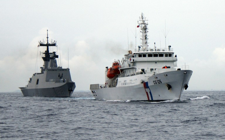 A Taiwanese naval Lafayette-class frigate (L) and a coast guard frigate setting sail from the island's southern port of Kaohsiung. Photo: AFP