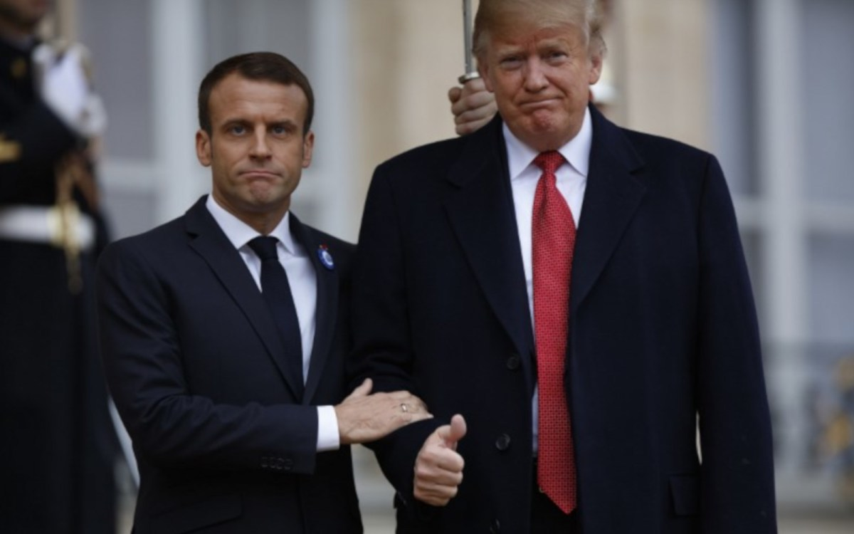 French President Emmanuel Macron welcomes US President Donald Trump prior to their meeting at the Elysee Presidential Palace. Photo: NurPhoto/Mehdi Taamallah