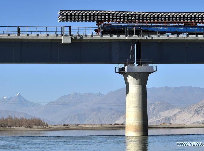 Track-laying work on a bridge near the Tibetan capital of Lhasa. Photo: Xinhua