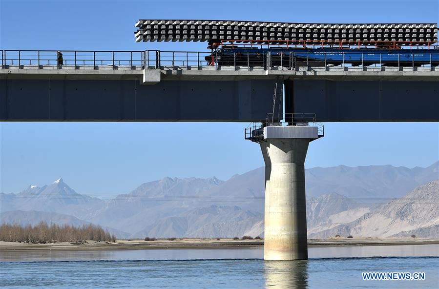 Track-laying work on a bridge near the Tibetan capital of Lhasa. Photo: Xinhua