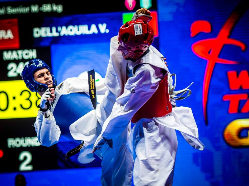 Anyone got an asprin? A classic round kick impacts the head protector during the 2018 World Taekwondo Grand Prix Final. Photo: Denis Sekretev/Asia Times