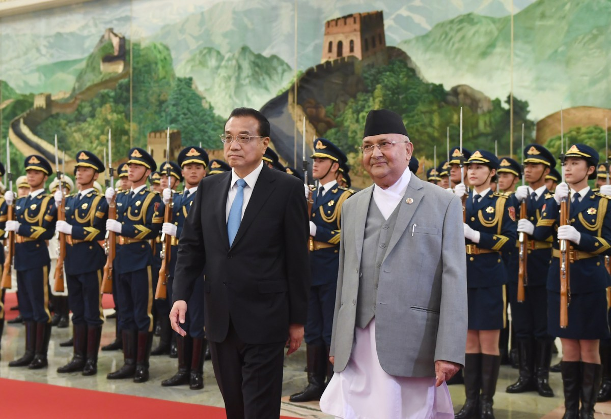 Nepal's Prime Minister K.P. Sharma Oli (R) reviews a military honor guard with Chinese Premier Li Keqiang at the Great Hall of the People in Beijing on June 21, 2018. Photo: AFP/Greg Baker