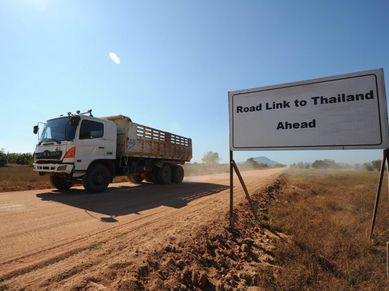 A truck passing a sign on a road leading to a deep sea port project in Mayingyi, part of the Dawei Special Economic Zone in Myanmar. Photo: AFP/Soe Than Win
