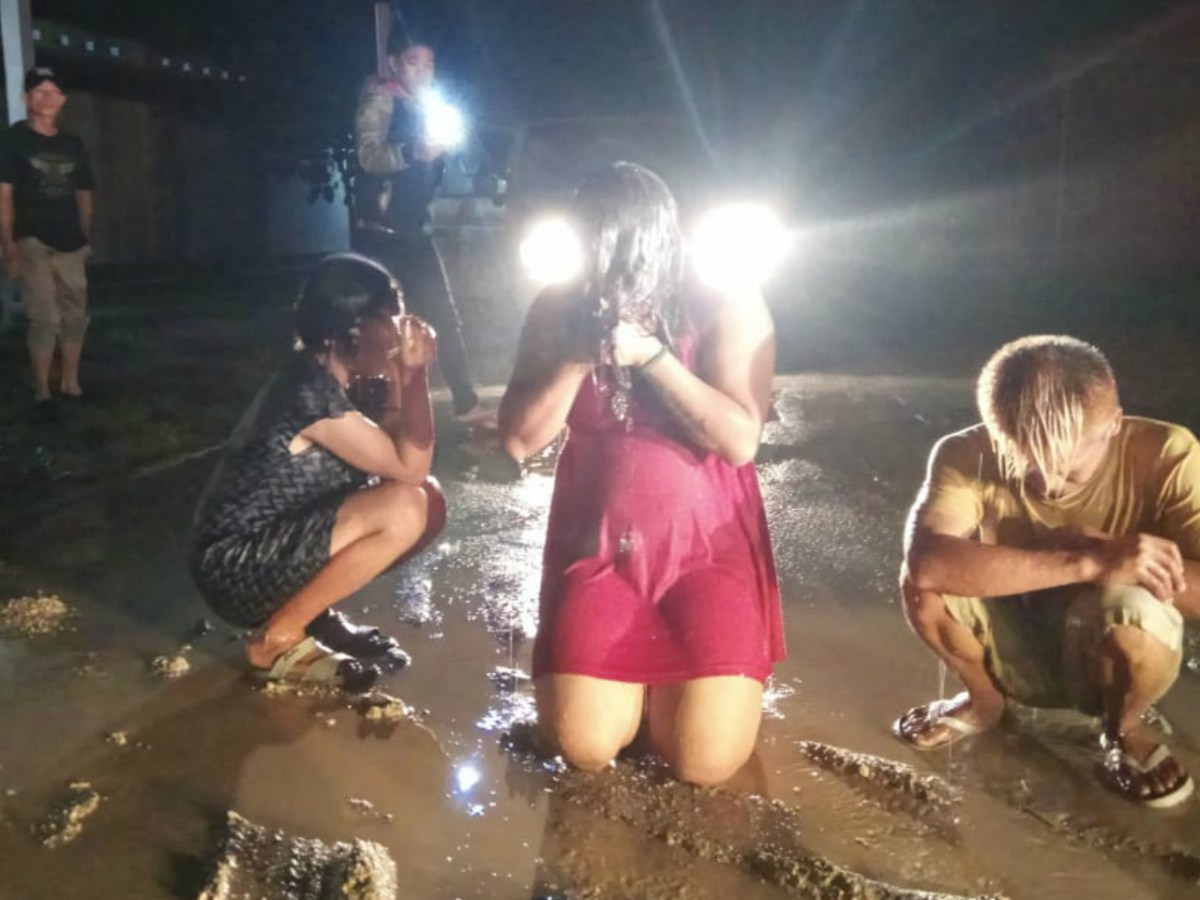 The three transgender women after being 'cleansed.' Photo: Twitter/@andreasharsono