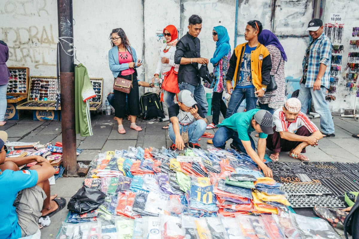 A flea market in Jakarta, Indonesia. Vendors and people are around the area. Photo: iStock
