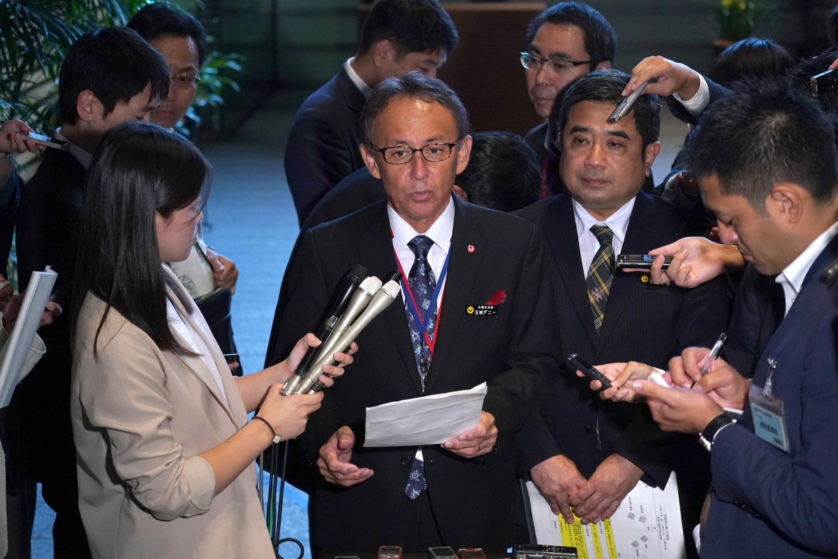 Okinawa Governor Denny Tamaki, center, speaks to journalists after meeting with Japanese Prime Minister Shinzo Abe in Tokyo on Oct 12. Photo: Eugene Hoshiko / AFP