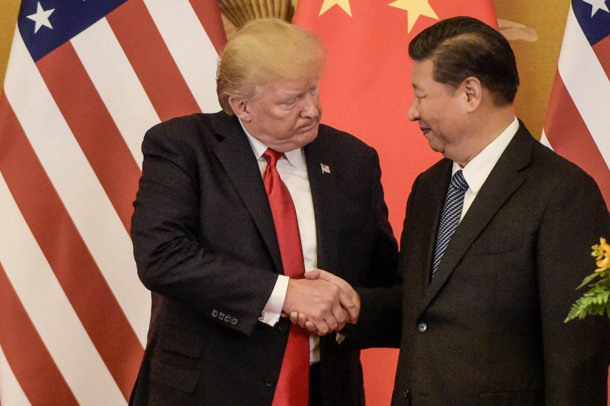 US President Donald Trump shakes hands with China's President Xi Jinping in Beijing's Great Hall of the People last year. Photo: AFP / Fred Dufour