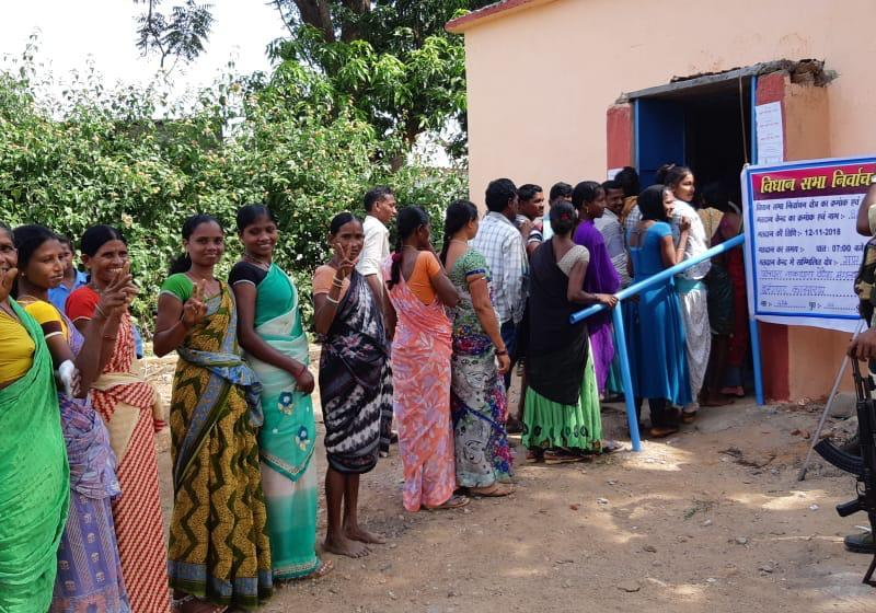 Voters in Kistaram village in Sukma line up to cast ballots amid tight security due to threats by local Maoists. Photo: 101 Reporters