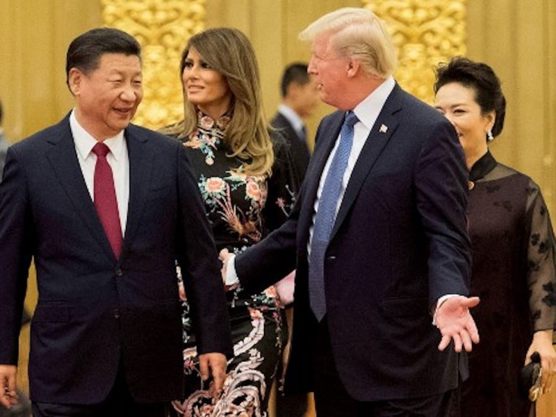 China's President Xi Jinping with US President Donald Trump in Beijing's Great Hall of the People last year. Photo: AFP / Jim Watson