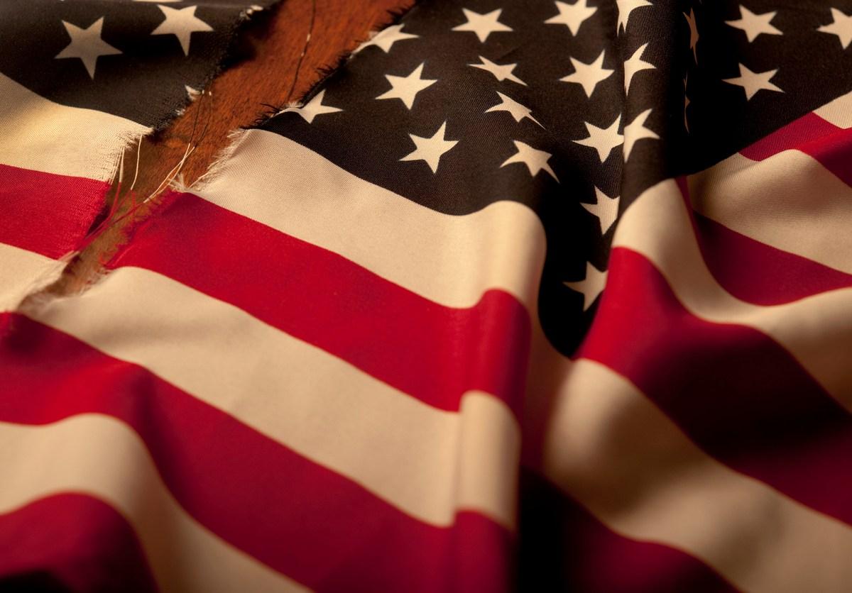 Torn American Flag.Photo: iStock