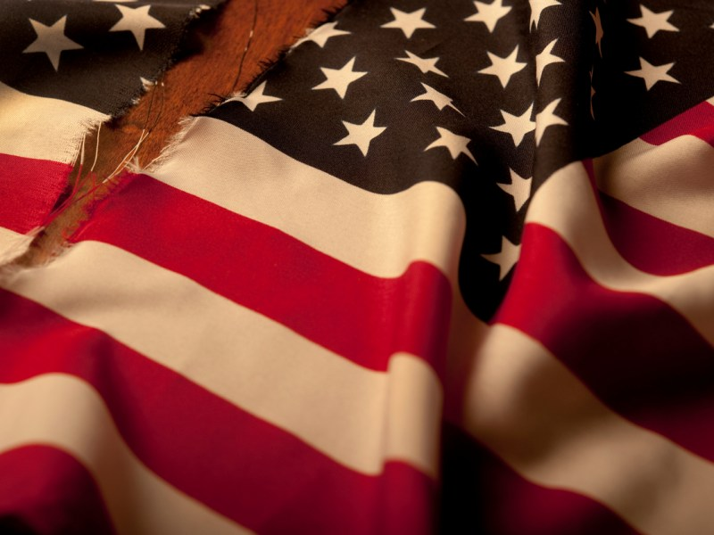 Torn American Flag.Photo: iStock